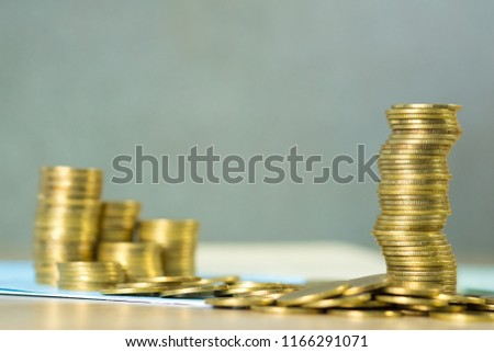 Stacks of coins and account book or credit card with copy space, finance and business finance, banking and savings concept idea. #1166291071