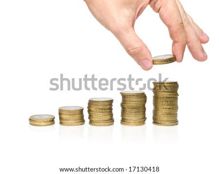 stacks of coins and humand hand isolated on white. savings concept
