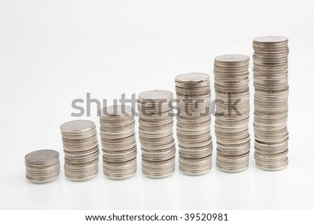 Stacks of coins isolated on white