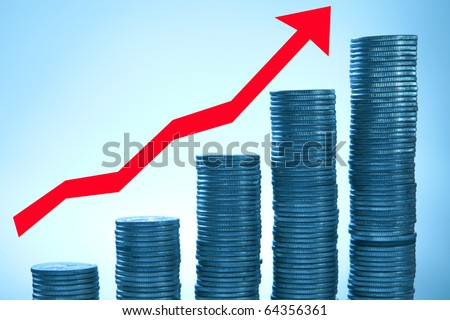 Stacks of coins on blue background with red arrow