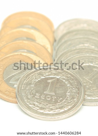 Stacks of coins on white background, polish currency money #1440606284
