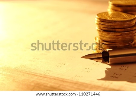 stacks of coins with numbers on documents