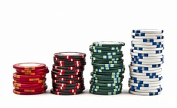 Stacks of colored poker chips isolated on white background