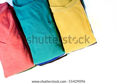 Stacks of colorful clothes on white background.
