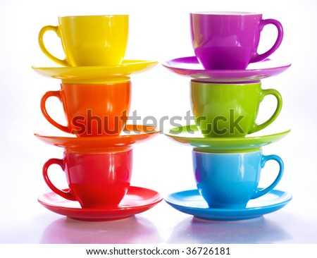 Stacks of colorful cups - stock photo
