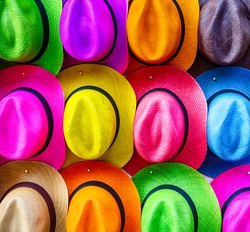 Stacks of colorful hats line the sidewalks in Cartagena's old city tempting tourists.
