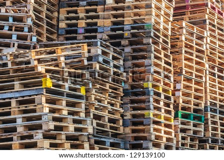 Stacks of colorful wooden euro pallets