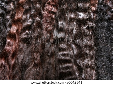stacks of dark wavy hair extensions