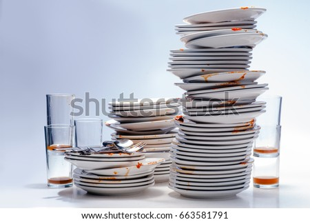 Stacks of dirty dishes.