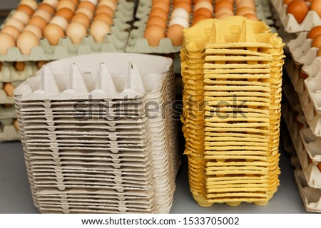 Stacks of disposable egg cartons