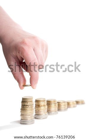 stacks of euro coins with hand, white background