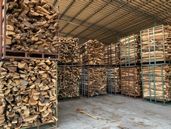 Stacks of firewood for industrial. Piles of firewood
