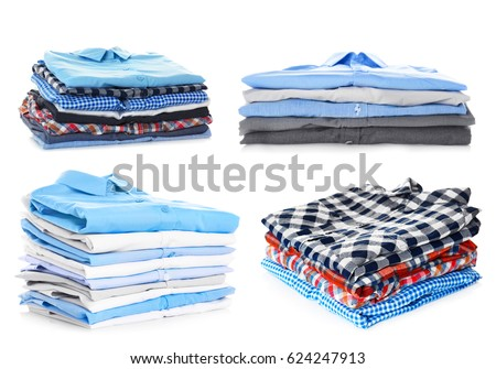 Stacks of folded clothes on white background #624247913