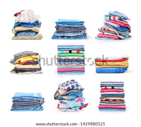 Stacks of folded clothes set isolated on a white background