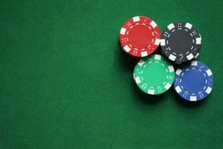 Stacks of gambling/poker chips on green background, casino concept