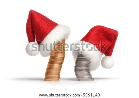 Stacks of gold and silver coins dressed in Santa's hats