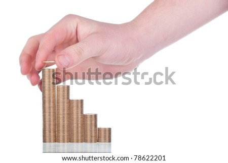 Stacks of gold coins and human hand