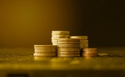 stacks of gold money coin background concept saving money