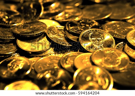 Stacks of money and coins representing success wealth and riches