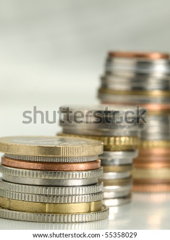 stacks of money coins of various currencies, closeup with shallow DOF , useful for various financial or economics themes