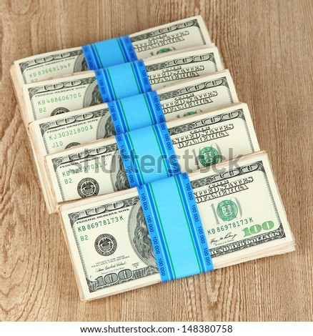 Stacks of money on wooden table