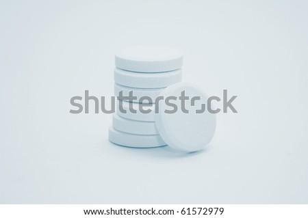 Stacks of multivitamin effervescent tablets, high key