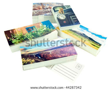Stacks of new postcards isolated on white. The cards are my production, I own the copyrights to all the images, no copyright infringement issues.