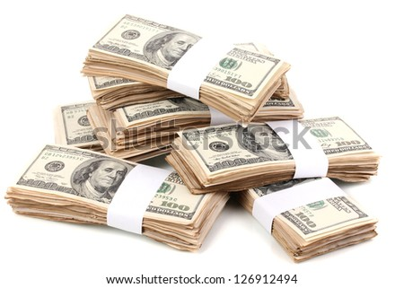 Stacks of one hundred dollars banknotes close-up isolated on white - stock photo