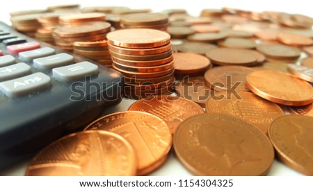 Stacks of Pennies Beside a Calculator