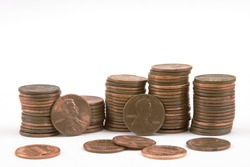 Stacks of pennies on white background.