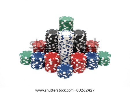 Stacks of poker chips in various colors are isolated on white.