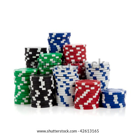Stacks of poker chips including red, black, white, green and blue on a white background