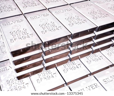 stacks of pure silver bars on piles of bullion