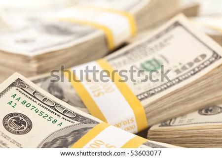 Stacks of Ten Thousand Dollar Piles of One Hundred Dollar Bills. - stock photo