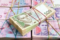 Stacks of Ukrainian hryvnia UAH banknotes. The money of Ukraine.