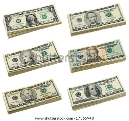 Stacks of US dollar bills in isolated white background