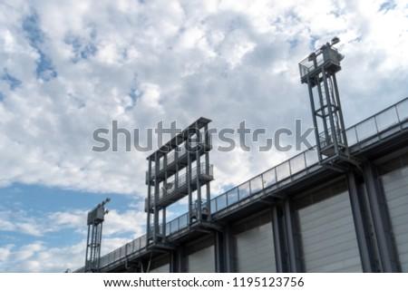 Stadium floodlights against cloudy sky #1195123756
