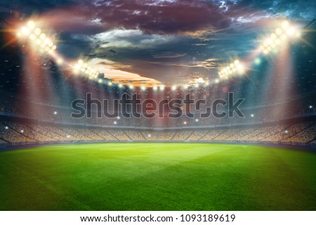 Stadium in the lights and flashes, football field. Concept sports background, football, night stadium. Mixed media, copy space. #1093189619