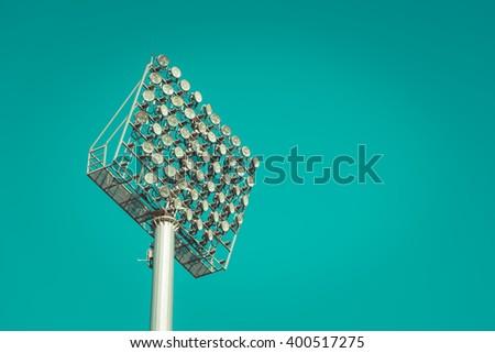 Stadium light against blue sky , vintage tone