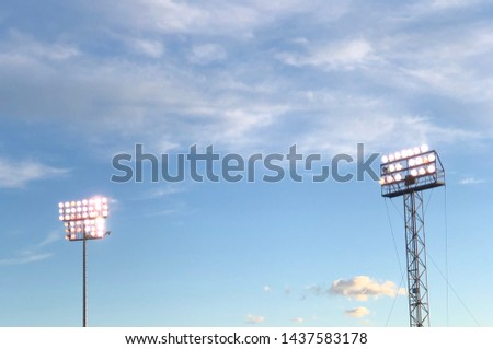 Stadium Lighting illuminating the baseball stadium at dusk #1437583178