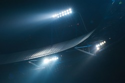 Stadium lights against dark night sky background. Soccer match lights.
