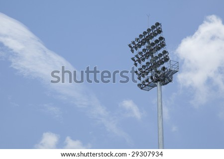 Stadium lights during the day with copy space