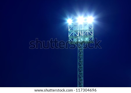 Stadium Lights With Blue Sky Background
