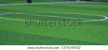 Stadium of football or soccer field with green grass. Sport indoor #1370140502