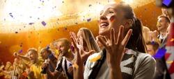 stadium soccer fans emotions portrait in yellow toning