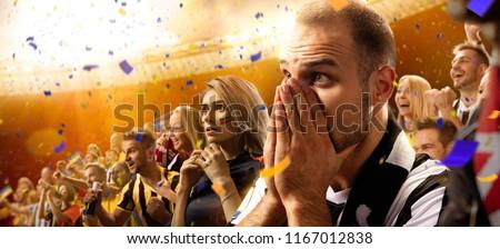 stadium soccer fans emotions portrait in yellow toning #1167012838