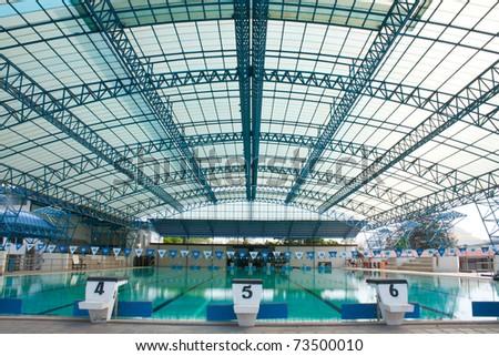 stadium, swimming pool as the next track, swimming.