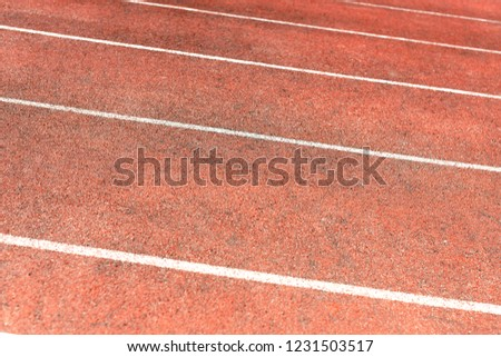 Stadium track for running and athletics competitions. New synthetic rubber treadmill. Empty racetrack. #1231503517