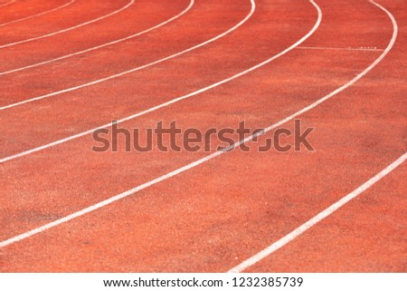 Stadium track for running and athletics competitions. New synthetic rubber treadmill. Empty racetrack. #1232385739