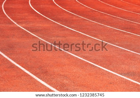 Stadium track for running and athletics competitions. New synthetic rubber treadmill. Empty racetrack. #1232385745